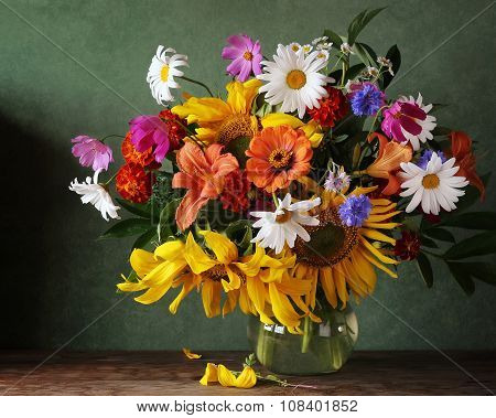 Still Life With A Bouquet Of Sunflowers, Camomiles And Other Flowers.