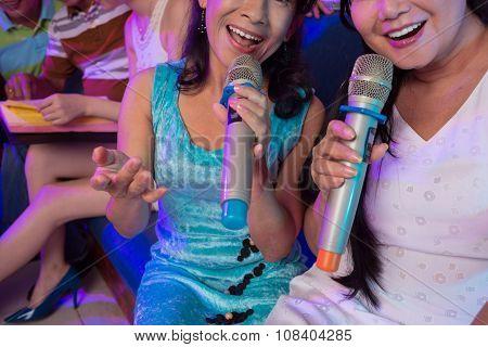 Singing in microphones