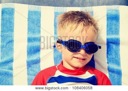 cute happy little boy at beach vacation