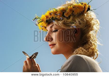 Lovely woman with a butterfly over blue sky