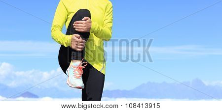 young fitness woman runner stretching