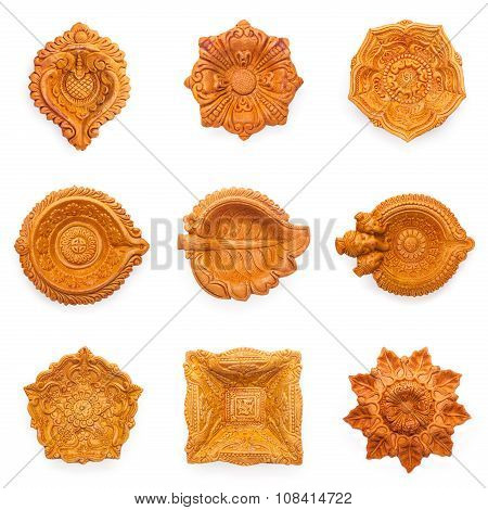 Top view Collage of beautiful designer clay lamps.