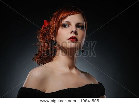 Portrait of an young attractive redhead woman