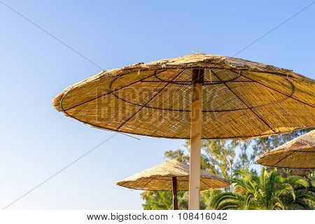 Beach Umbrella Or Awning On A Rack