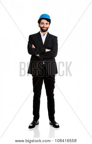 Smiling handsome businessman with hard hat.