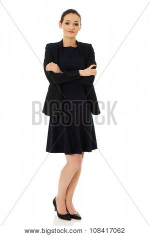 Beautiful confident businesswoman with crossed arms.