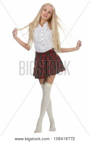 Stylish fashionable blonde woman in white shirt and plaid skirt. Isolated on white