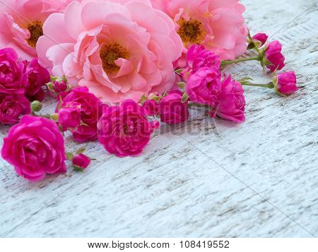 Pink Curly Roses And Small Vibrant Pink Roses In The Corner