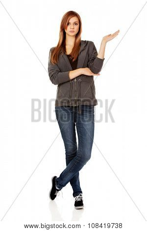 Teenage woman presenting something on open palm,