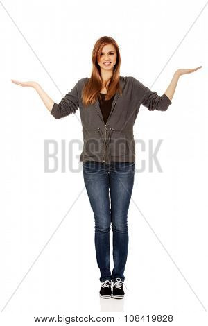 Teenage woman presenting something on open palms.