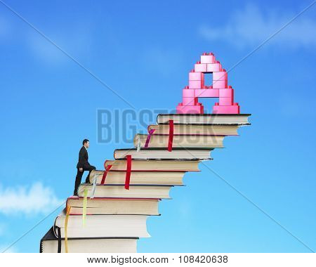 Businessman Climbing Books Stairs Toward Alphabet A Shape Blocks
