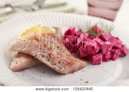 Marinated herring with salad on a plate