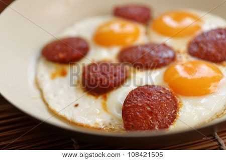 Fried eggs with sucuk in a frying pan