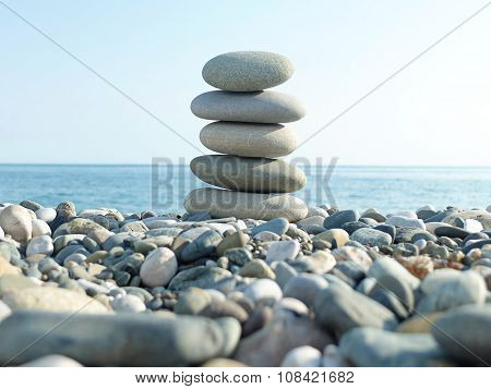 Sea landscape and pyramid of pebbles