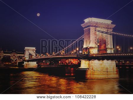 Szechenyi Chain Bridge On The River Danube Between Buda And Pest, In Budapest, The Capital Of Hungar