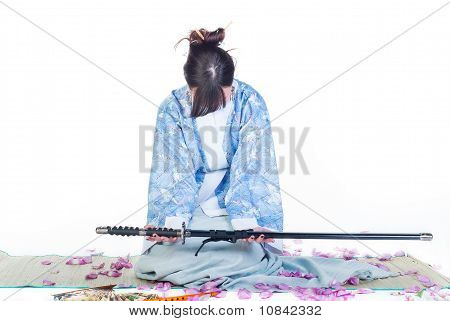Submissive Geisha In Blue Kimono With Katana