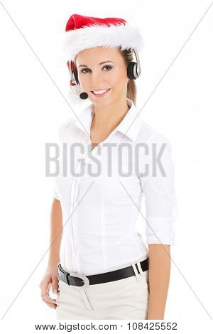 Smiling call center operator wearing red Christmas hat.