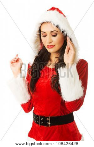 Santa woman touching her head and looking down.
