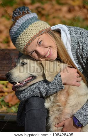 Smiling Girl And Retriever