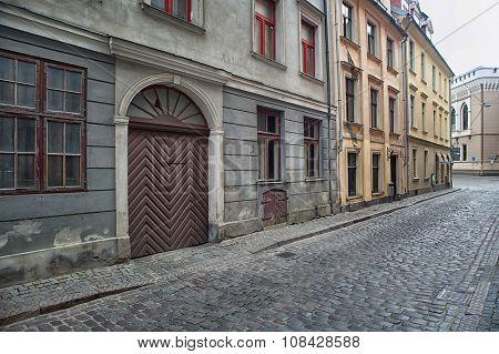 Narrow medieval street in old town of Riga city, Latvia.