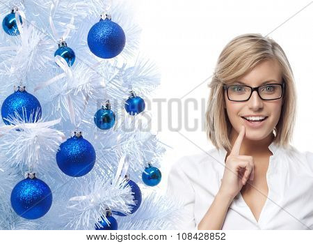 portrait of attractive  caucasian smiling woman isolated on white studio shot looking at camera wearing glasses new year christmas tree blue balls