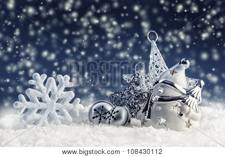 Snowman with christmas decoration and ornaments - jingle bells star snowflakes in sn