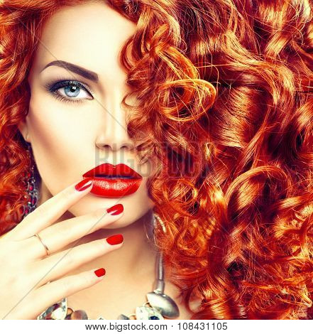 Beauty young woman with curly red hair, perfect make up and manicure. Permed hair. Glamour lady, Beauty Girl. Beautiful Woman Portrait. Blond Wavy Hair, perfect make up