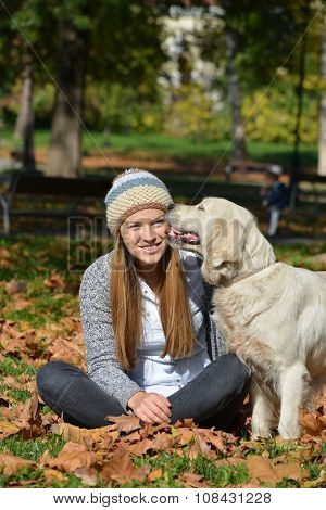 Girl In Autumn Leaves And Dog