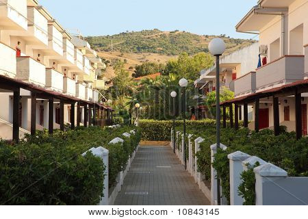 Little Street Between Three-storeyed Cottages In Summer In Day-time