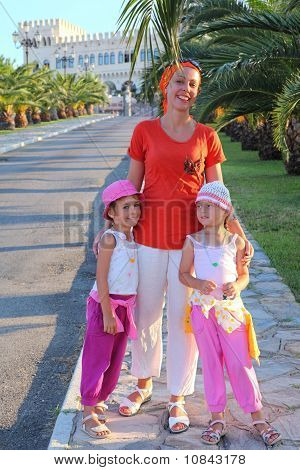 Woman With Two Girls Is In  Way Which Conducts In  Palace With Towers And Beautiful Registration