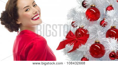 portrait of attractive  caucasian smiling woman isolated on white studio shot looking at camera christmas new year tree