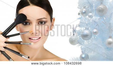 portrait of attractive  caucasian smiling woman brunette isolated on white studio shot brushes makeup christmas new year tree