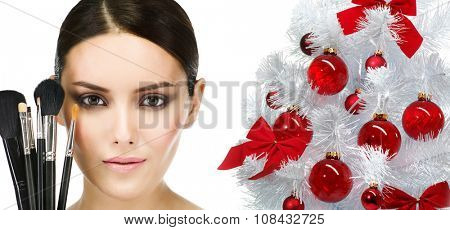 make up  beauty woman face brushes portrait of attractive young caucasian girl brunette  close up  isolated on white  studio shot head and shoulders looking at camera eyes lips christmas new year tree