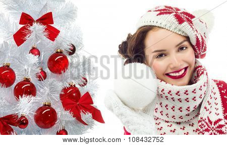 attractive young caucasian woman in warm clothing  in studio isolated on white smiling christmas new year tree