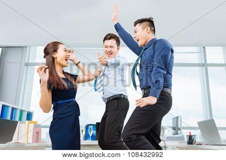 Dancing coworkers