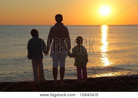 Mother With Two Children, Embarking On Hands Stand On  Beach
