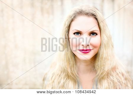 Portrait of a beautiful woman with wavy blonde hair