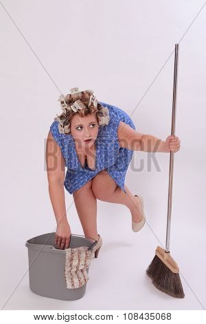 Woman With Hair Curler Holding Broom And Pail