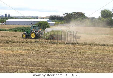 Tractor & Baler Making Pea Vine Hay