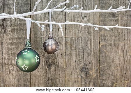 Glass Christmas Balls Hanging Over Wooden Background