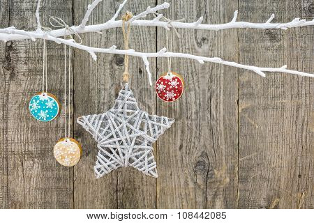 Gingerbread Cookies With Star Hanging On Wooden Background