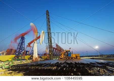 working oil-rig of oilfield day and night