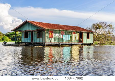 House On The River In The Amazon Rainforest, Manaos, Brazil