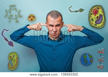 Male from in a blue shirt fingers plugged ears want to hear a se