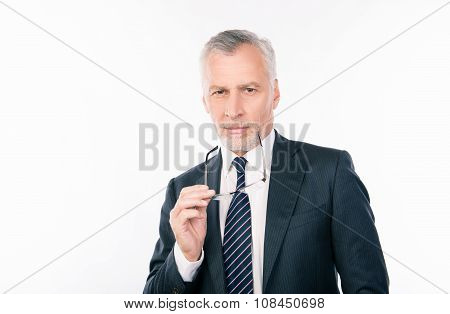 Handsome Intelligent  Old Businessman Holding Glasses And Ponder