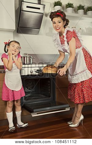 Housewife And Her Daughter Baking Bread
