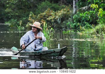 Local Fisherman In The Amazon Rainforest, Manaos, Brazil