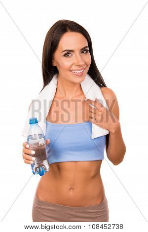 Slender Girl With Towel Holding A Bottle With Water