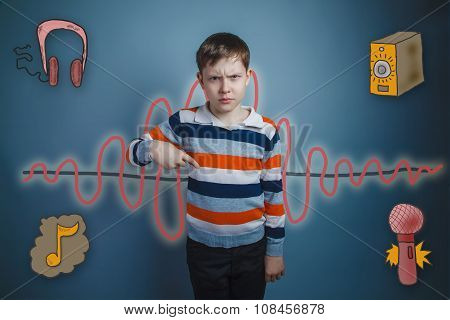 Teen boy frowned and points a finger down the sound wave music r