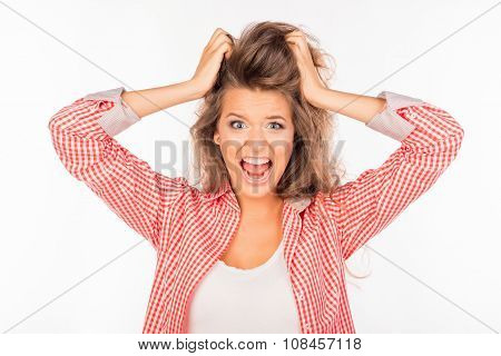 Portrait Of Crazy Young Woman Shouting And Holding Hair